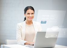 Woman with laptop computer and virtual screen Royalty Free Stock Photography