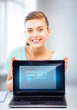 Woman with laptop computer and virtual screen Stock Photos