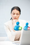 Woman with laptop and contact icon Stock Photography