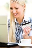 Woman with laptop and credit card Royalty Free Stock Photography