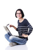 Woman with a laptop and a credit card Stock Photo