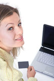 Woman with laptop and credit card Stock Images