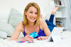 Woman with laptop and credit card Stock Photo