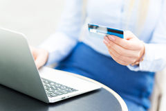 Woman with laptop and credit card Royalty Free Stock Image