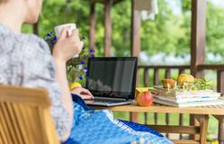 Woman with laptop and cup. Stock Image