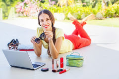 Woman with laptop. Woman doing online shopping, she received her order stock photo