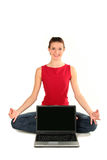 Woman with laptop doing yoga. Woman sitting in lotus position with laptop Royalty Free Stock Photo