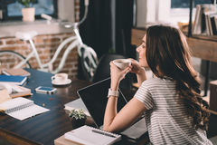 Woman with laptop drinking coffee. Attractive woman with laptop drinking coffee Stock Photography