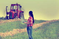 Woman with laptop in the field Royalty Free Stock Images