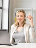 Woman with laptop and finger up Royalty Free Stock Photo