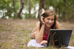 Woman with laptop in forest Stock Photos
