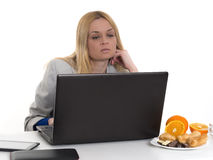 Woman with laptop and fresh oranges Stock Photography