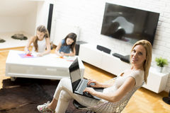 Woman on laptop Stock Images