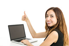 Woman with a laptop giving thumbs up Royalty Free Stock Images
