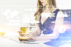 Woman with laptop, graphs and formulas Stock Photo