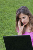 Woman laptop grass Stock Photo