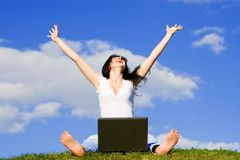 Woman with laptop on the green grass Royalty Free Stock Photography