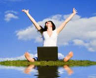 Woman with laptop on the green grass stock photography