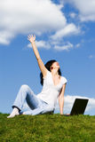Woman with laptop on the green grass Royalty Free Stock Photo