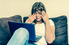 Woman with laptop having tired and sore eyes Royalty Free Stock Photography