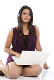Woman with laptop and headphones Stock Images
