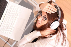 Woman with a Laptop and Headphones Royalty Free Stock Photo
