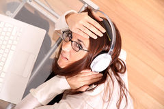 Woman with a Laptop and Headphones Royalty Free Stock Photography