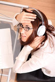 Woman with a Laptop and Headphones Royalty Free Stock Images