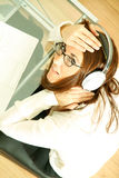 Woman with a Laptop and Headphones Stock Photo