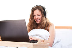 Woman with laptop and headset Royalty Free Stock Photography