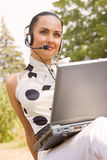 Woman with laptop and headset Royalty Free Stock Photo