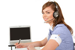 Woman with a laptop and headset Stock Images