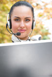 Woman with laptop and headset Stock Photo