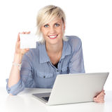 Woman With Laptop Holding Blank Card Stock Photo