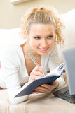 Woman with laptop at home Royalty Free Stock Image