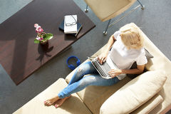 Woman with laptop at home Stock Photo