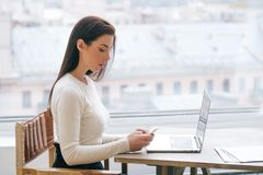 Woman with laptop home working using internet. Indoor shot stock photo