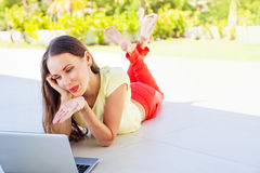 Woman with laptop. Joyful woman with laptop sending an air kiss Stock Images