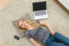 Woman With Laptop In Living Room Royalty Free Stock Photography