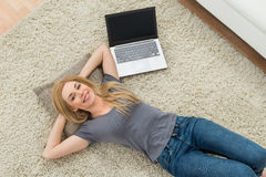 Woman With Laptop In Living Room Stock Photography