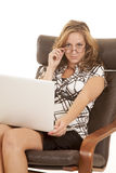 Woman laptop look over glasses sit Royalty Free Stock Photo