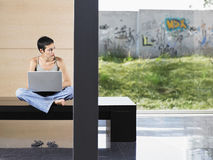 Woman With Laptop Looking Away Stock Photos