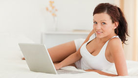Woman with a laptop looking into the camera Stock Images