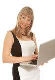 Woman with laptop looking to the camera Stock Images