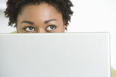 Woman With Laptop Looking Up Royalty Free Stock Image