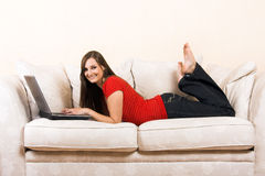 Woman with a laptop on a lounge Royalty Free Stock Photography