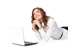 Woman with laptop lying down on the floor Stock Photos