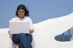 Woman with laptop in a mediterranean terrace Royalty Free Stock Photos