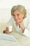 Woman with laptop and milk Stock Image