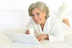 Woman with laptop and milk Stock Photos